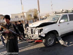 Afghan police secure the site of Sunday's deadly suicide attack in Kabul.