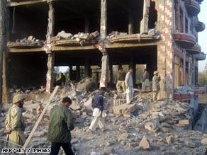 Pakistani security officials inspect the site of a suicide attack in Mingora last month.