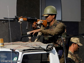 An Indian soldier joins the beefed up security detail at New Delhi airport.