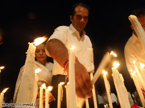 Mourners light candles Thursday during a memorial service for those killed in the terror attacks in Mumbai.