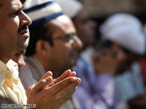 Muslims are shown at prayer Friday in Mumbai.
