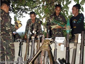 Filipino soldiers check weapons captured from Moro Islamic Liberation Front militants in November.