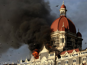Flames and smoke gush from the Taj Mahal hotel in Mumbai, India, on November 27.