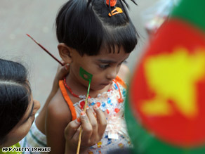 A girl with the national flag painted on her cheek marks Victory Day in Dhaka, Bangladesh, Tuesday.