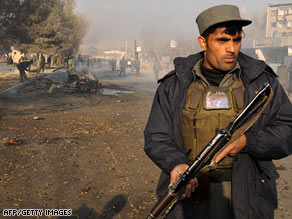 An Afghan policeman guards the scene of a suicide attack in Kabul on November 27.