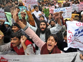 Activists supporting Jamaat-ud-Dawa chant slogans during a protest in Lahore on Friday.