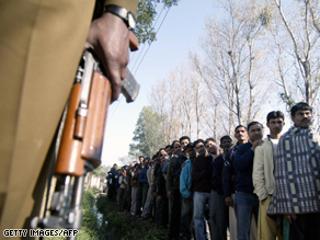 Voters line up in Jammu amid tight security.