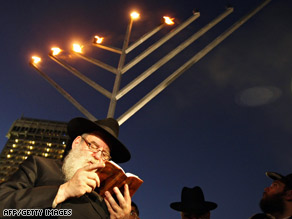 Rabbi Moshe Kotlarsky recites a prayer in observance of Hanukkah on Thursday in Mumbai, India.