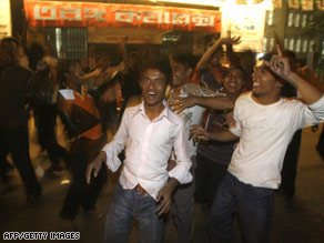 Supporters of Bangladesh's Awami League Party celebrate in Dhaka on Monday.