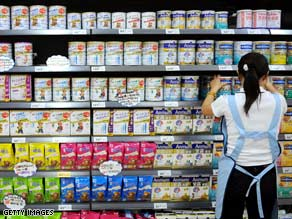 A salesgirl arranges powdered milk in China's Sichuan province in September.