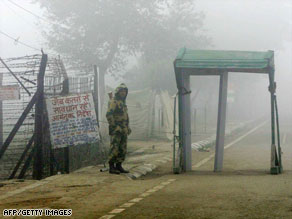 An Indian border guard stands on duty at the India-Pakistan Wagah Border Post crossing.