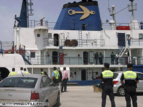 Security forces cordon off the Ocean Alert, an Odyssey Marine Exploration ship, in July 2007.