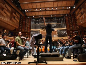 El Sistema graduate Gustavo Dudamel seen here conducting has been described as &quot;classical music's hottest young podium property.&quot;