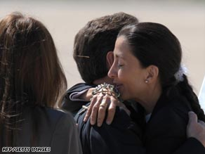 Ingrid Betancourt, center, hugs her daughter Melanie and son Lorenzo in Bogota, Colombia, on Thursday.