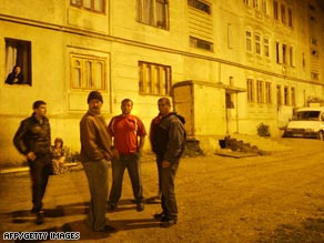 South Ossetians stand in the street during a night of shelling in Tskhinvali.