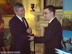 Dan Glass, right, takes hold of the British PM's right arm just before he was about to receive his award.