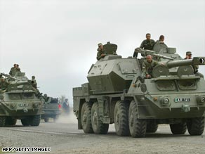 Georgian troops in armoured personnel carriers deploy to support the campaign to regain control of South Ossetia.
