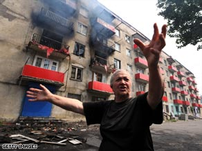 A Gori resident outside her apartment block, which was shelled during the conflict.