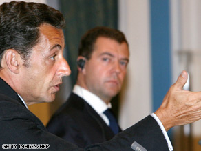 Nicolas Sarkozy, left, and Dmitry Medvedev outline the deal and the problems ahead.