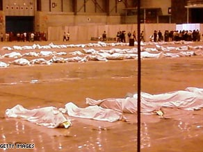 The victims of the crash were first laid out at a Madria convention center.
