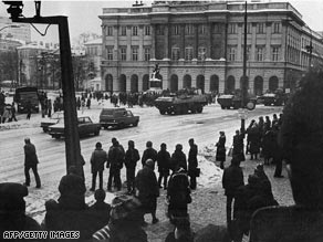 Polish policemen watch a demonstration near the University in Warsaw in December 1981.