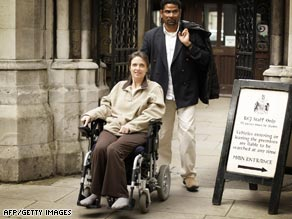 Debbie Purdy and her husband Omar Puente pictured outside London's High Court.
