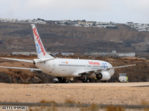 The Air Europa Boeing-737 sits parked at the end of the runway at the airport in Lanzarote.