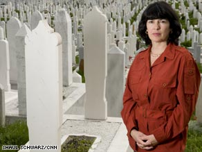 "CNN's Christiane Amanpour in a Sarajevo cemetery; she returned to Bosnia for ""Scream Bloody Murder."""