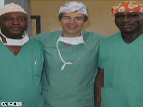 British surgeon David Nott with two colleagues in a Congo field hospital where Nott saved a boy's life.