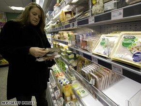 A shopper inspects Irish pork products at a supermarket in Belfast, in Northern Ireland.