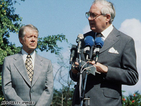 U.S. President Jimmy Carter watches UK PM James Callaghan speak at a 1979 meeting in Guadeloupe.