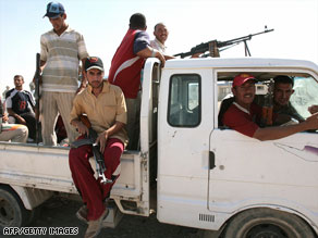 Former Iraq insurgents, pictured in 2007, in Anbar province have allied to oppose al Qaeda in Iraq.