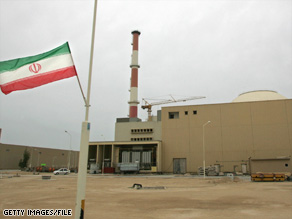 An Iranian flag flies outside the building containing the reactor of Bushehr nuclear power plant, south of Tehran.