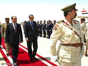 Iraqi Prime Minister Nuri al-Maliki, left, welcomes Turkish leader Recep Tayyip Erdogan to Baghdad on Thursday.