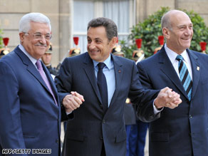Nicolas Sarkozy, center, welcomes Mahmoud Abbas, left, and Ehud Olmert to Paris, France, on Sunday.