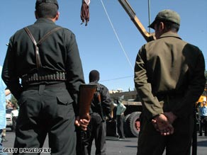 A convicted Iranian drug dealer is hanged from a crane in the southern city of Shiraz in September.