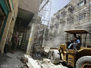 Workers clear debris during reconstruction along al-Mutanabi Street in central Baghdad, Iraq, in May.