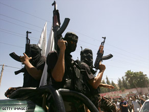 Masked men attend a Gaza City funeral for six Hamas loyalists killed in a bombing blamed on Fatah.