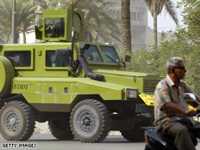 An armored vehicle of a foreign private security company drives in central Baghdad in October 2007.