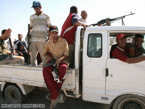 Members of the Sunni Anbar Awakening, once insurgents, guard a meeting of Sunni and Shiite leaders in 2007.