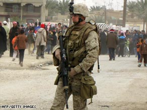 A U.S. soldier on patrol in Ramadi's market earlier this year. U.S. troops will remain in the province to support Iraqi forces.