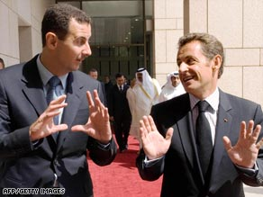 French President Nicolas Sarkozy (right) and Syria's President Bashar al-Assad