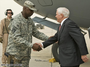 Robert Gates is greeted Monday at Baghdad International Airport by Army Lt. Gen. Lloyd Austin.