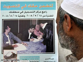 An Iraqi looks at an ad for elections, planned for October but postponed over Kurdish objections.