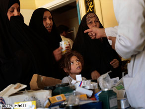 An Iraqi doctor hands out medications at a neighborhood clinic in Baghdad.
