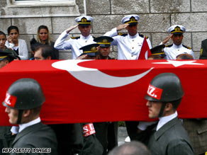 Members of Turkey's honor guard carry flag-draped coffins of two soldiers killed in clashes with the PKK.