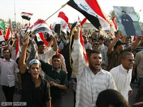 Thousands staged a mass march through Baghdad, Iraq, on Saturday to protest a planned U.S.-Iraq security deal.