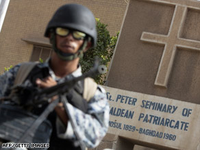 An Iraqi policeman patrols outside a church in the Baghdad district of Dora last Tuesday.