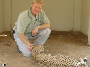 Michael Holmes pictured with a cheetah at Baghdad's zoo in 2004.
