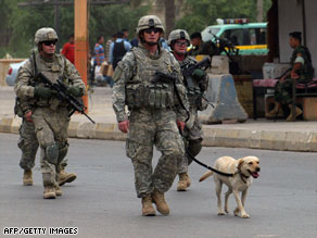 U.S. soldiers patrol the streets of Baghdad's central district on Saturday.
